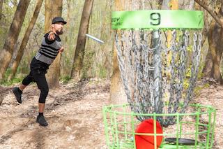 Man playing on a disc golf course