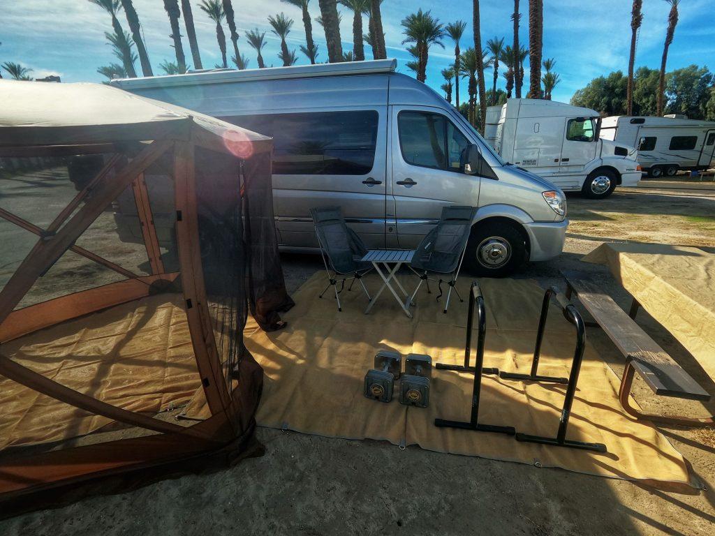 Fitness equipment arranged next to RV van