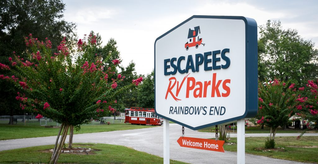 New sign on display at Rainbow's End RV Park, advertising Escapees RV Parks and welcoming guests home.